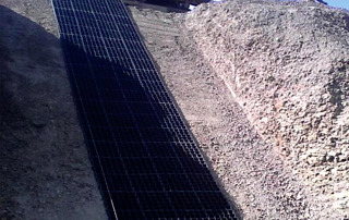 EcoGrid being fitted on a sloping surface within a hill dune